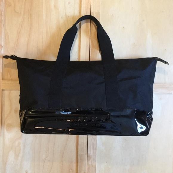Burberry Handbags - Burberry Fragrances Black Weekender Tote Bag a4b894a2c885d